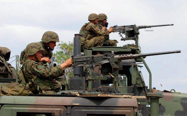 这款武器被士兵们誉为战场上的人头收割机,一把枪可以抗衡一个团